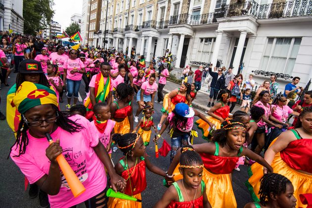 Dancers on the parade route at the Notting Hill Carnival in west