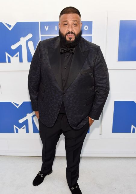 DJ Khaled might have been a little bit overdressed in his shiny tux and Gucci loafers but we won't count that against him. He looks sharp and comfortable.