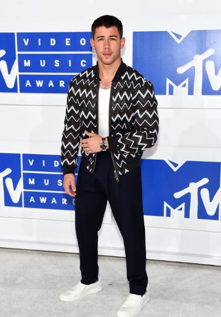 If you want the Cliffs Notes on what's happening in menswear at the moment look at Nick Jonas's higher-waist pants, low-cut undershirt, and macho Louis Vuitton bomber.