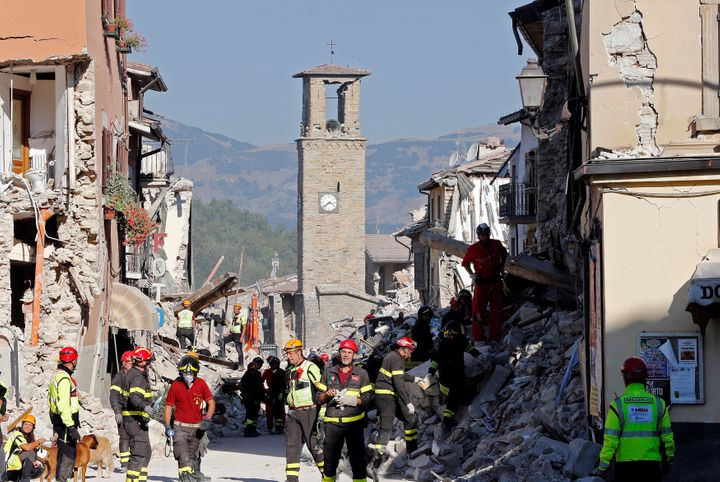 Firefighters and rescuers try to pick up the pieces afteran earthquake devastatedAmatrice in central Italy.
