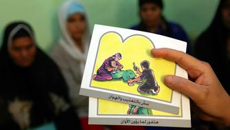 - PHOTO TAKEN 13JUN06 - A counsellor holds up cards used to educate women about female genital mutilation (FGM) in Minia June 13, 2006. The practice of FGM dates back over two thousand years in Egypt and is widely practiced in all levels of society for [Muslims and Christians] alike. [Many organizations like UNICEF] have funded programs to help educate people about the risks and dangers of FGM in order to change people's opinions on this procedure which is seen by many as a necessary social norm. Picture taken June 13, 2006.