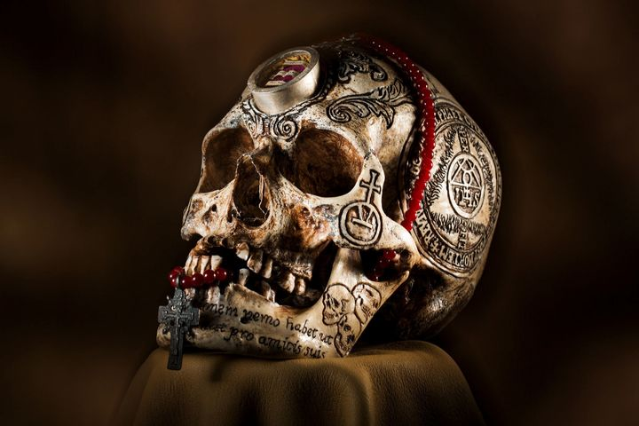 Artist Zane Wylie carved this human skull and embedded a relic from Saint Aloysius Gonzaga, who died while helping plague vic