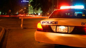 A police car on duty during the night.