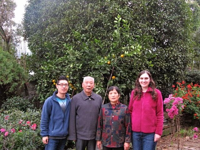A family photo with my husband Jun Yu (far left) and his parents in front of their home in China.