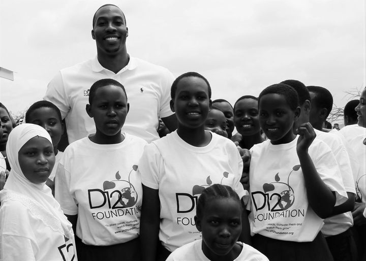 Dwight Howard along with students during the groundbreaking ofKipok Secondary School.