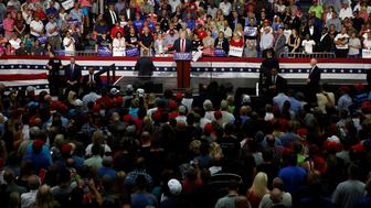 Republican presidential nominee Donald Trump speaks onstage during a campaign rally in Akron, Ohio, U.S., August 22, 2016.   REUTERS/Carlo Allegri