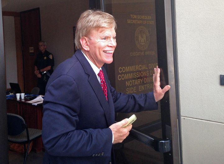David Duke leaves the Louisiana secretary of state's office after filing to run as a Republican for United States Senate in Baton Rouge on July 22.