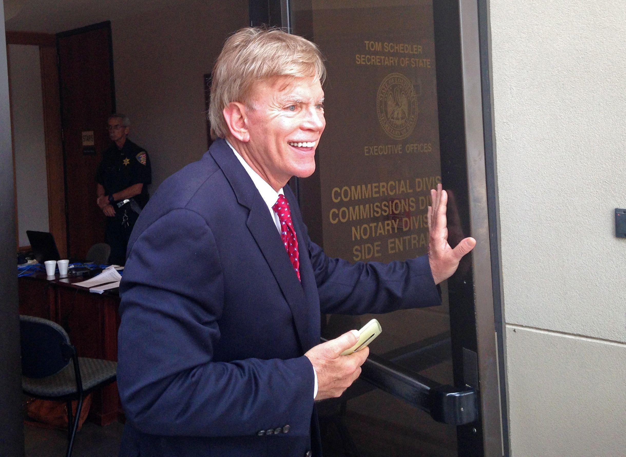 David Duke leaves the Louisiana secretary of state's office after filing to run as a Republican for United States Senate in B