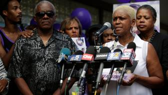 CHICAGO, IL - AUGUST 28: Diann Aldridge, the mother of Nykea Aldridge (second from right) speaks to reporters during a prayer vigil for her daughter as her sister and Jolinda Wade, right, looks on outside Willie Mae Morris Empowerment Center on August 28, 2016 in Chicago, Illinois. Nykea Aldridge, a cousin of NBA star Dwyane Wade, was shot in the head and killed when a stray bullet struck her while she was pushing her baby in a stroller Friday afternoon near an elementary school on Chicago's south side. (Photo by Joshua Lott/Getty Images)