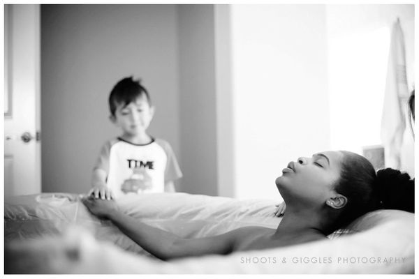 This mom gets a quiet, supportive touch from her son as she works through a contraction.