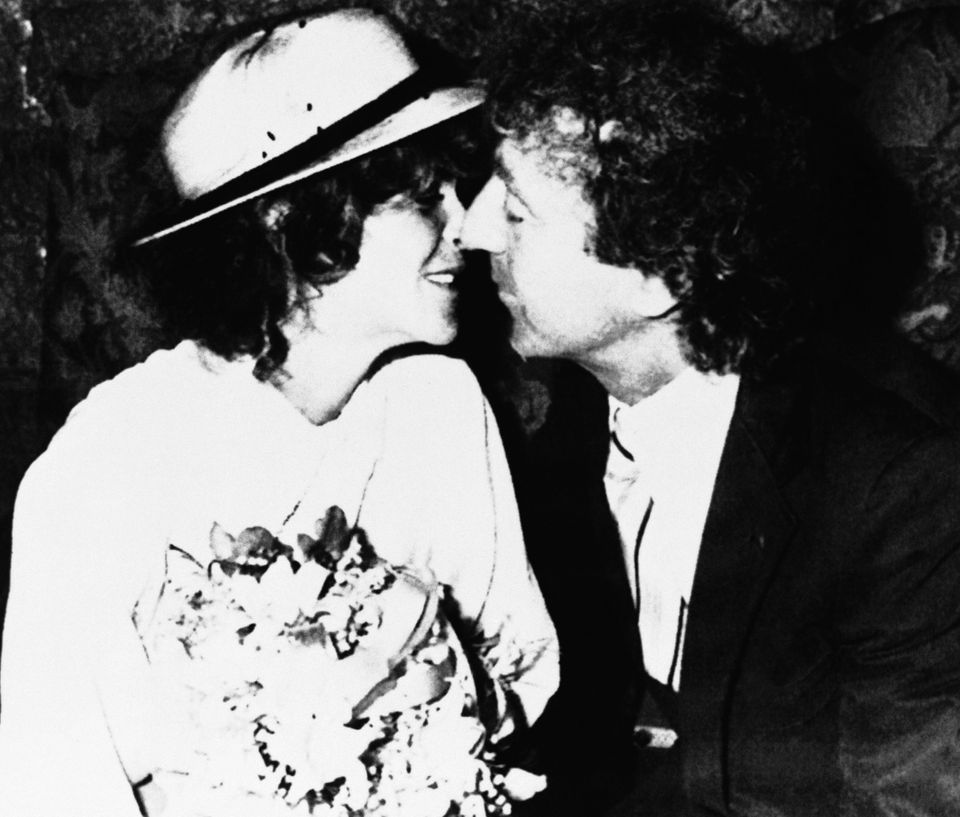 Comedian Gilda Radner, left, and Gene Wilder, kiss for photographers in this photograph following their private wedding cerem