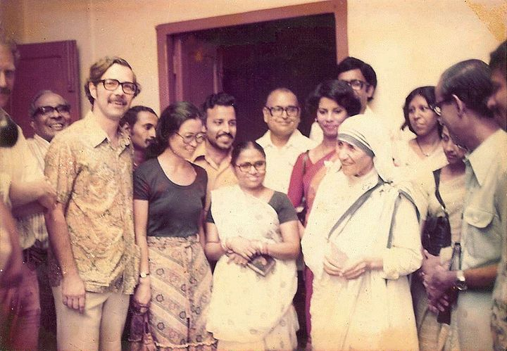 The CRS Calcutta staff, including Jim DeHarpporte on far left in glasses, with Mother Teresa. This was the day that it was an