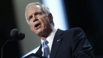 Senator Ron Johnson, a Republican from Wisconsin, speaks during the Republican National Convention (RNC) in Cleveland, Ohio, U.S., on Tuesday, July 19, 2016. Donald Trump sought to use a speech by his wife to move beyond delegate discontent at the Republican National Convention, only to have the second day open with an onslaught of accusations that his wife's speech lifted phrases from one delivered by Michelle Obama in 2008. Photographer: Andrew Harrer/Bloomberg via Getty Images