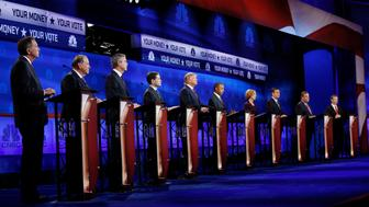 Republican U.S. presidential candidates (L-R) Governor John Kasich, former Governor Mike Huckabee, former Governor Jeb Bush, U.S. Senator Marco Rubio, businessman Donald Trump, Dr. Ben Carson, former HP CEO Carly Fiorina, U.S. Senator Ted Cruz, Governor Chris Christie and U.S. Rep. Rand Paul participate in the 2016 U.S. Republican presidential candidates debate held by CNBC in Boulder, Colorado, October 28, 2015. REUTERS/Rick Wilking