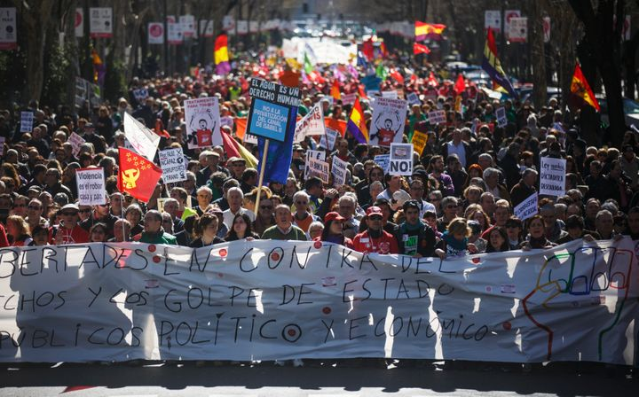 Protesters march against government austerity measures in Madrid last year.