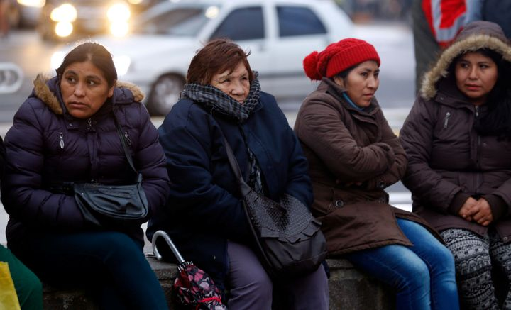 Demonstrators huddle against the cold during a protest over electricity and gas prices in Buenos Aires this year.