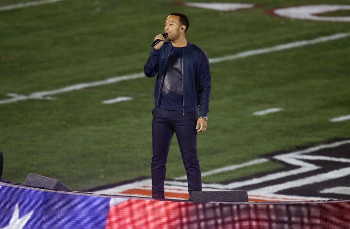 This Jan. 6, 2014 file photo shows John Legend singing the national anthem before the NCAA BCS National Championship college