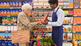 Woman in grocery store with clerk
