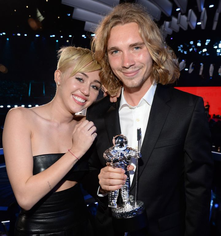 Miley Cyrus and Jesse Helt attend the 2014 MTV Video Music Awards.