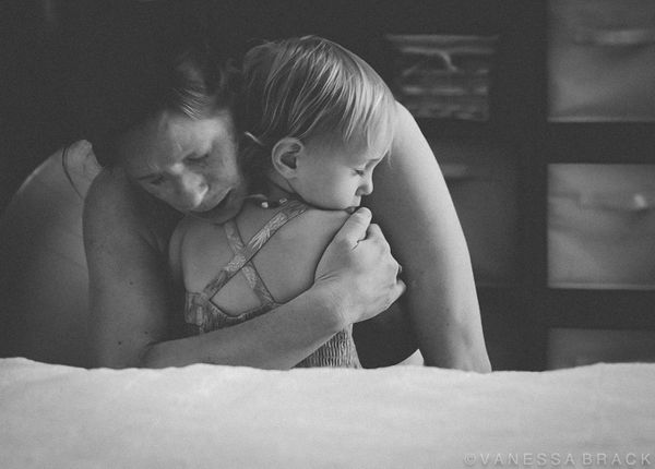 This mother's firstborn held her tight as she breathed through a contraction. You can feel her strength enveloping them both