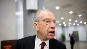 UNITED STATES - MARCH 17: Sen. Chuck Grassley (R-IA) speaks with a reporter as he waits for the Senate subway on Thursday, March 17, 2016. (Photo By Bill Clark/CQ Roll Call)