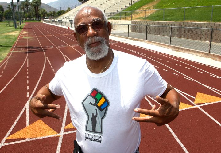John Carlos, who won bronze in the1968 Olympics, stands on the campus track at Palm Springs High School, where he is a