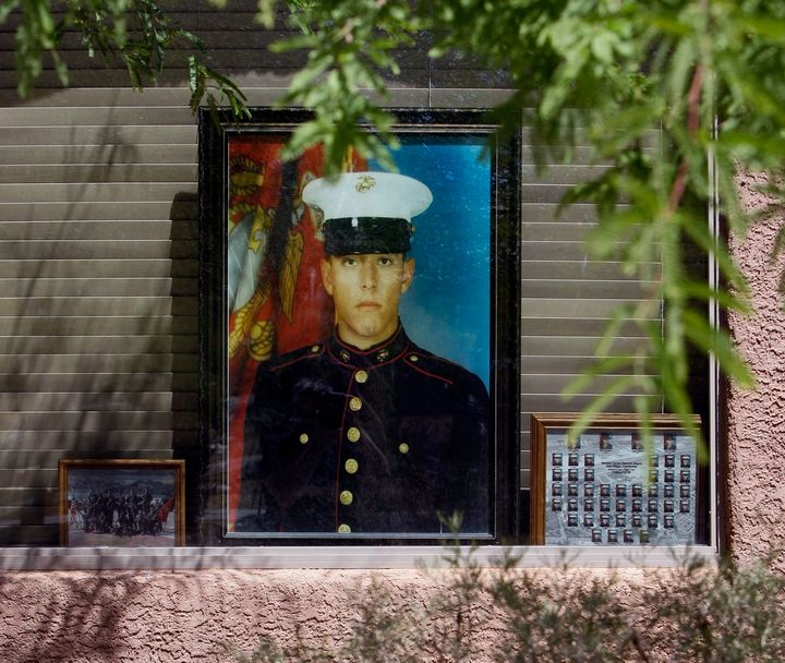 A portrait of Marine Jose Guerena Ortiz sits on display in the window of his home in Tucson, Arizona.