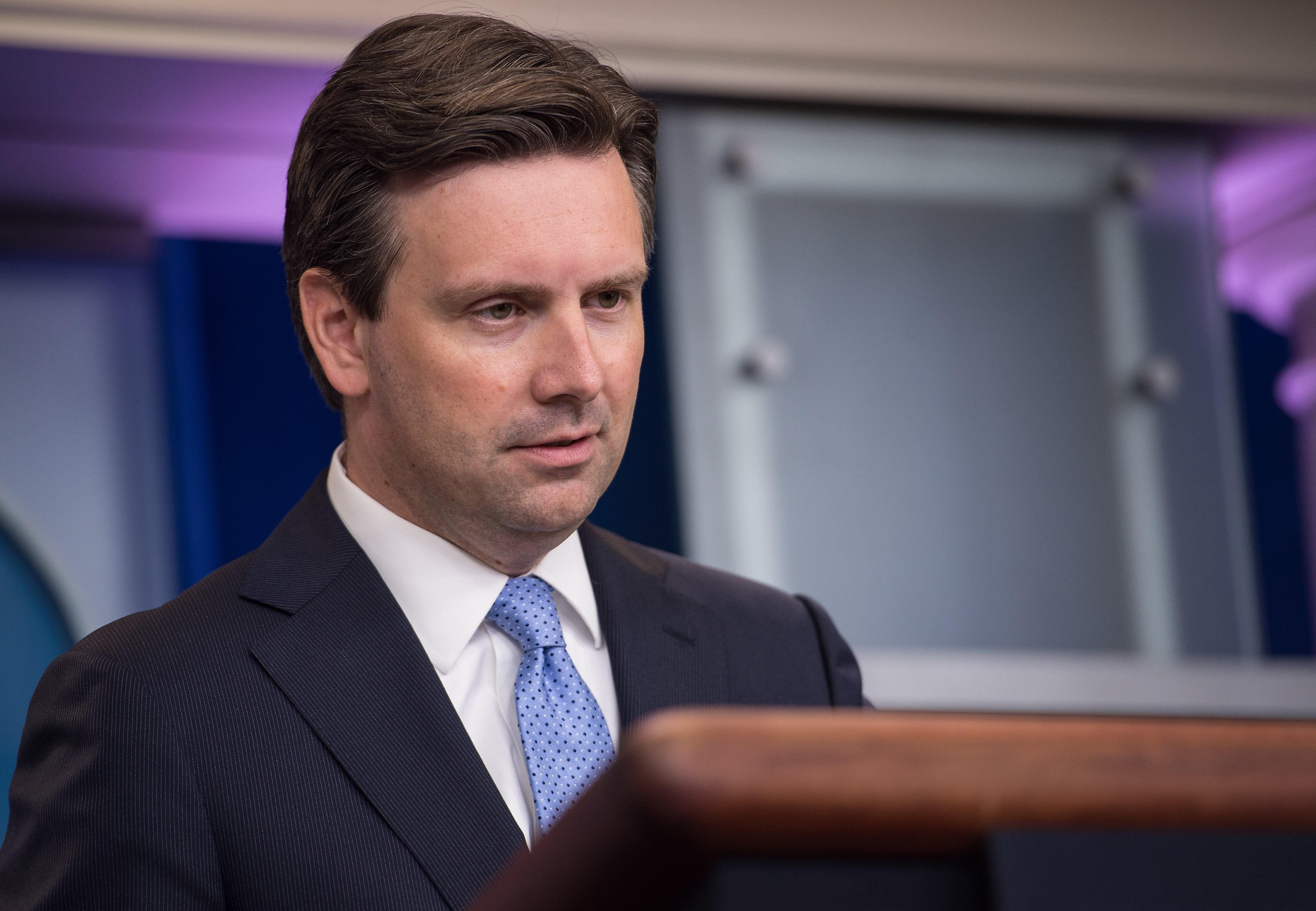 White House spokesman Josh Earnest speaks during the daily press briefing at the White House in Washington, DC, on August 30, 2016. The White House said Augugst 30, 2016 it still hoped to wrap up negotiations on a massive EU-US trade deal by year's end, after France and Germany called the pact into question. White House spokesman Josh Earnest said President Barack Obama will send his top trade negotiator to Europe in the coming months, pointedly rejecting French demands that negotiations be halted.  / AFP / NICHOLAS KAMM        (Photo credit should read NICHOLAS KAMM/AFP/Getty Images)