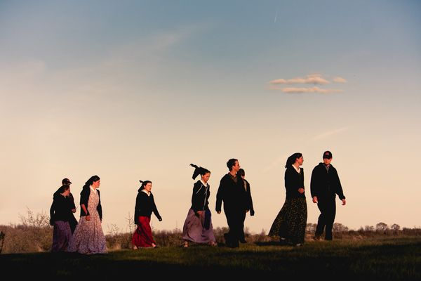 Young Hutterite men spend an evening with girls visiting from another colony.