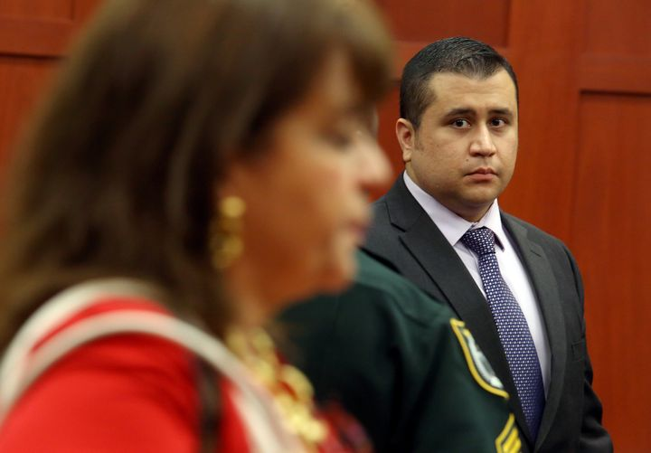 George Zimmerman glances at State Attorney Angela Corey during the start of the lunch recess during George Zimmerman trial in
