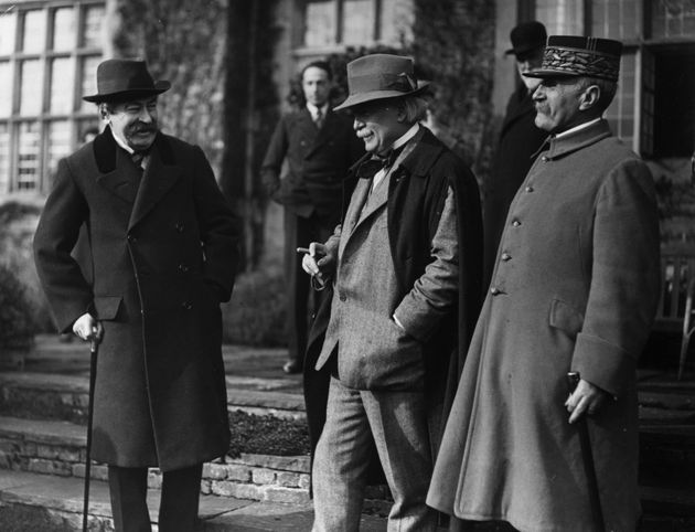 Coalition Prime Minister David Lloyd George (centre) with French soldier Ferdinand Foch (right) at Chequers...