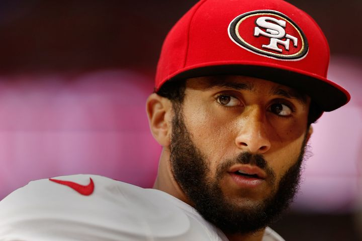 Colin Kaepernick watches from the sidelines during an NFL game against the Arizona Cardinals at the University of Phoeni