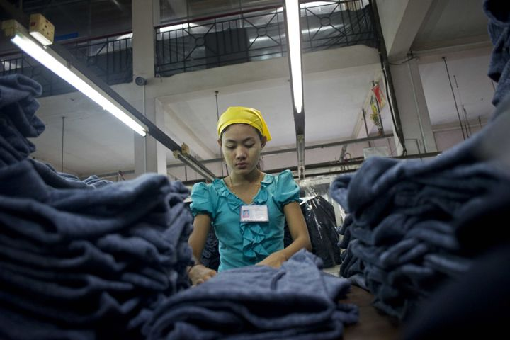 A woman works at the Shweyi Zabe garment factory in Shwe Pyi Thar Industrial Zone in Yangon on Sept. 18, 2015.