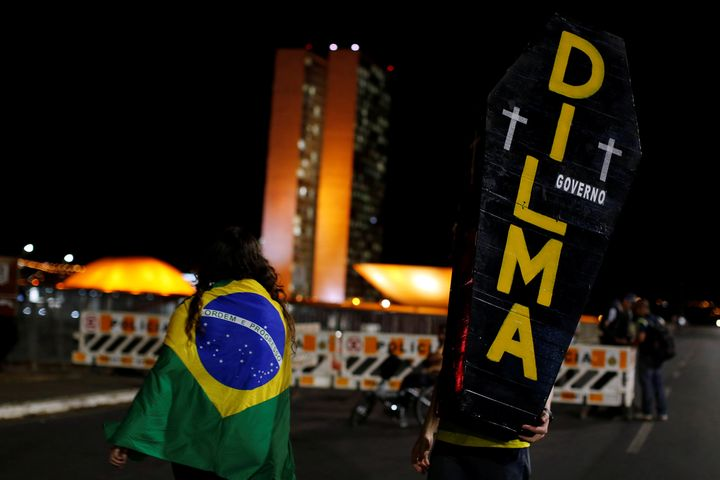 A pro-impeachment demonstrator holds a cardboard coffin painted with the name of Brazil's suspended president Dilma Rousseff
