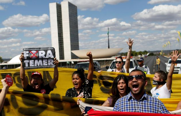 Supporters of Brazil's suspended President Dilma Rousseff protest in front of the Brazilian congress...