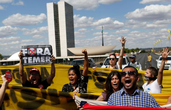 Supporters of Brazil's suspended President Dilma Rousseff protest in front of the Brazilian congress during the final session