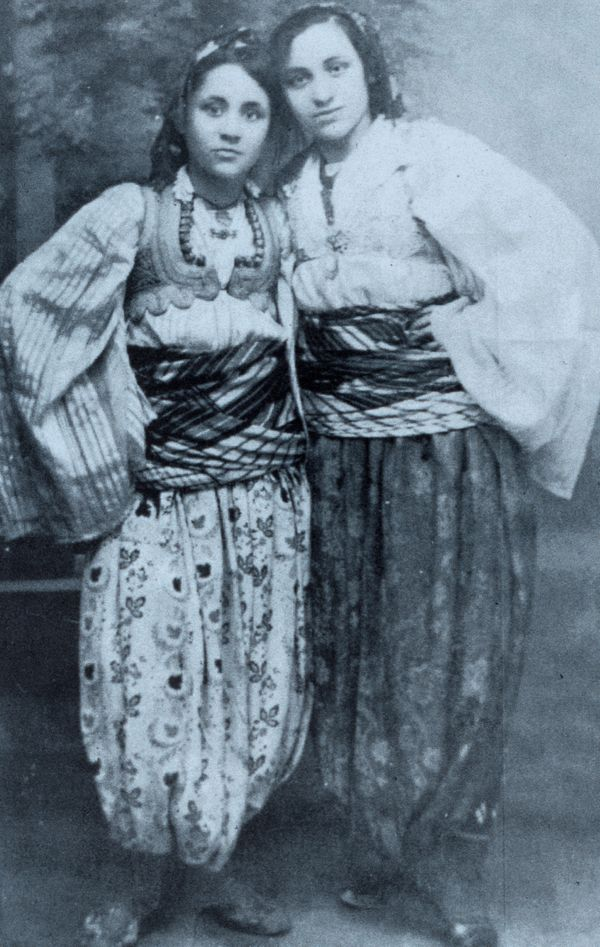 Agnes Gonxhe Bojaxhiu with her sister Aga, in Macedonian traditional costume.