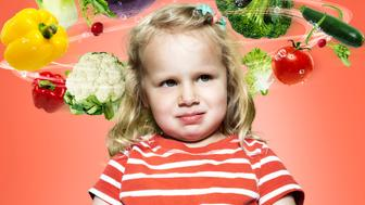 Little girl with flying vegetables around her head, Composite