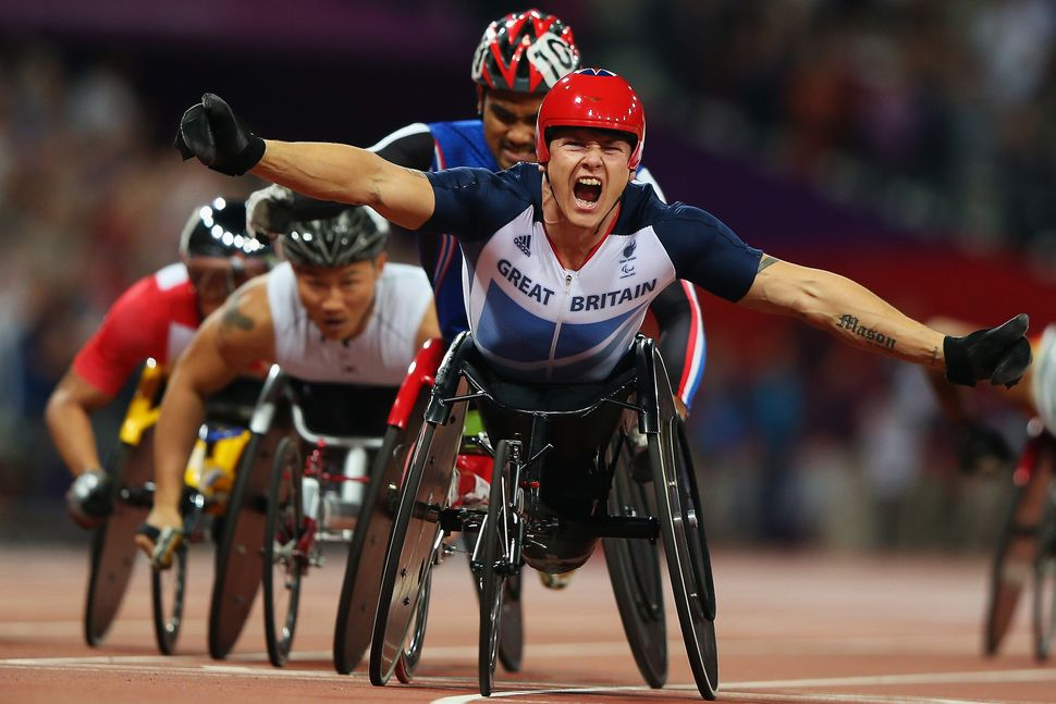 Great Britain's David Weir celebrates winning the men's 1500-meter at the London 2012 Paralympic Games.