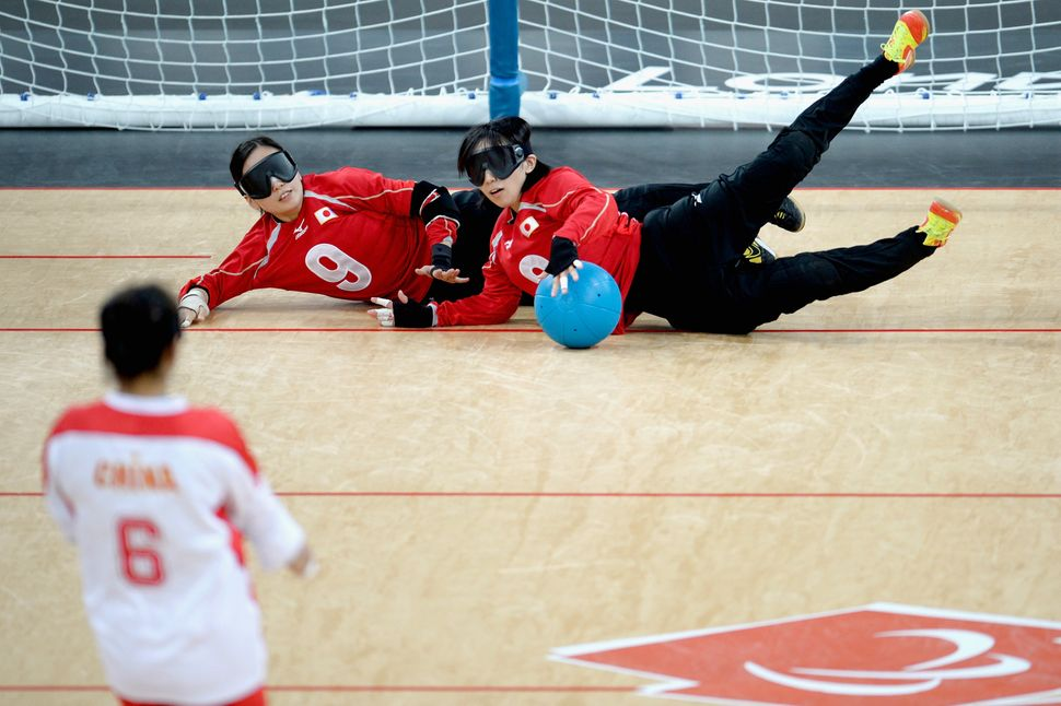 Rie Urata and Akiko Adachi of Japan block the ball at the 2012 Paralympic Games.