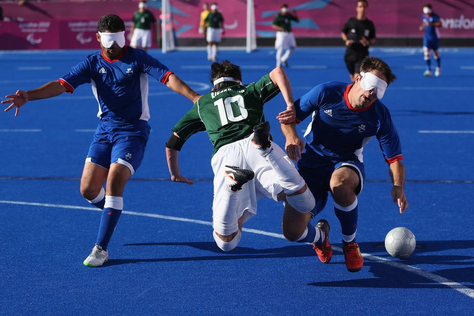 Ricardo Steinmetz Alves of Brazil clashes with David Labarre and Abderrahim Maya of France in 2012.