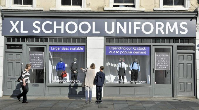 Cancer Research UK has transformed a shop front into an XL school uniform shop to show the new norm of larger school uniforms.