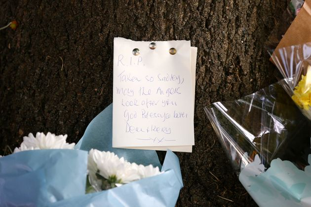 Flowers and a note left in tribute at the