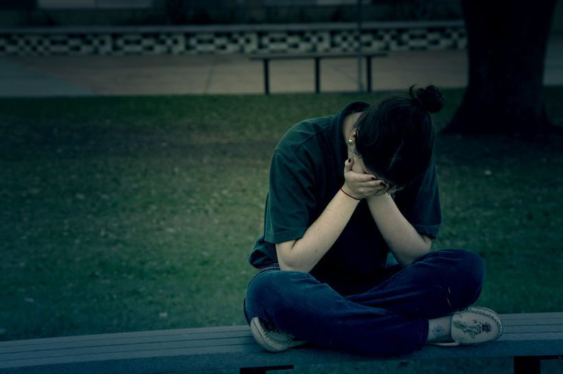 Grieving young woman