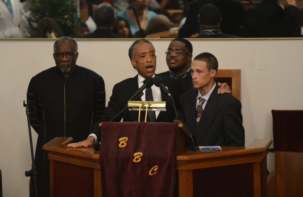 Rev. Al Sharpton introduces Orta during the funeral service for Eric Garner on July 23, 2014, in Brooklyn, New York.