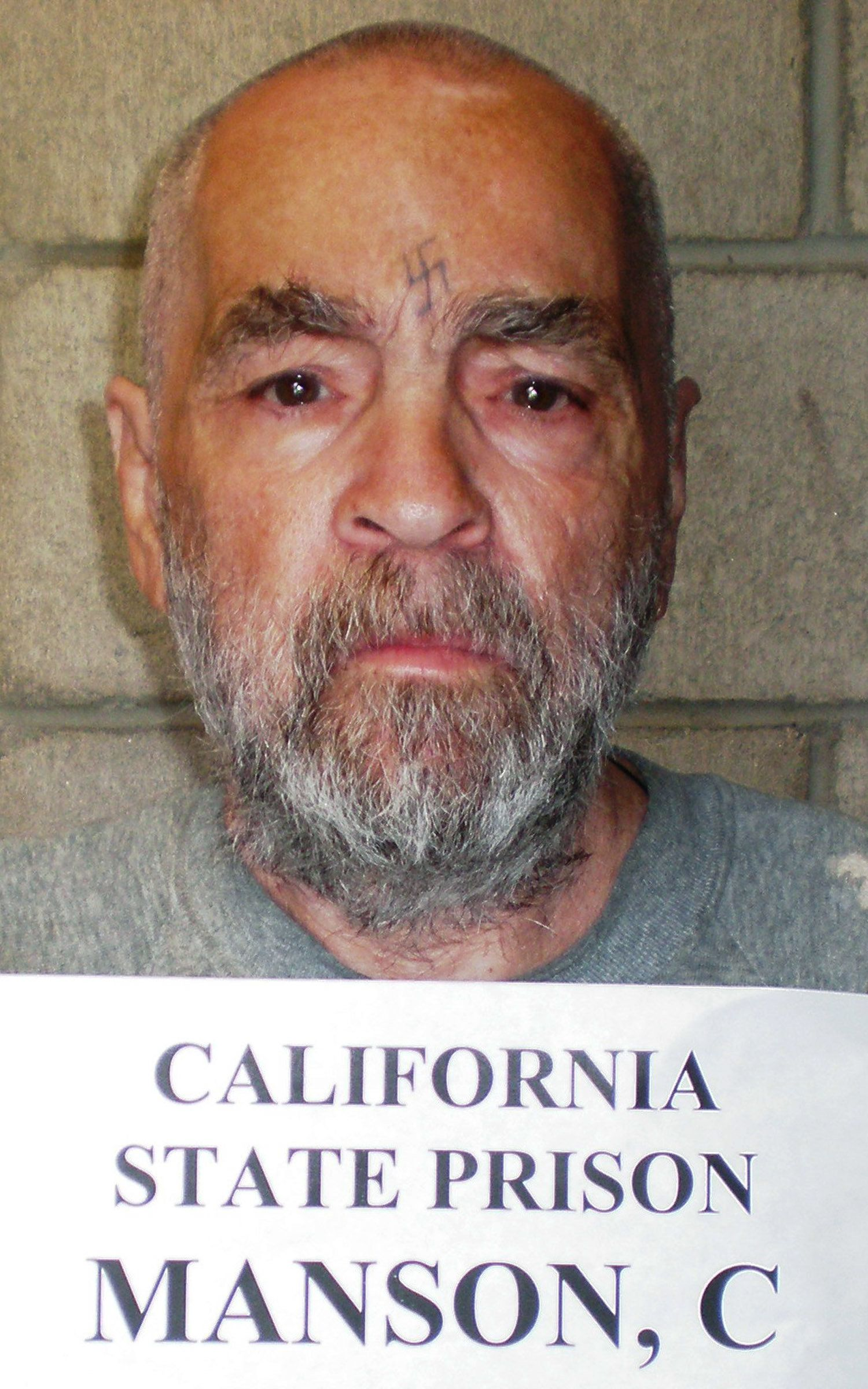 Convicted murderer Charles Manson, 74, is shown in this handout image released March 18, 2009 from Corcoran State Prison in California. Manson is serving a life sentence for his conspiracy role in the killing of seven people in the Tate-LaBianca murders in Los Angeles, 1969. REUTERS/Courtesy of Corcoran State Prison/Handout (UNITED STATES CONFLICT SOCIETY HEADSHOT IMAGE OF THE DAY TOP PICTURE) FOR EDITORIAL USE ONLY. NOT FOR SALE FOR MARKETING OR ADVERTISING CAMPAIGNS