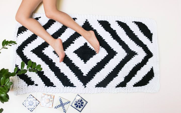 "<a href=""http://www.weareknitters.com/knitting-kits/decoration/antwerp-carpet"" target=""_blank"">Antwerp Carpet kit, $76</a>"