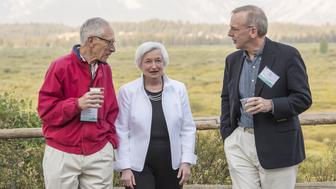 Stanley Fischer, vice chairman of the U.S. Federal Reserve, left, Janet Yellen, chair of the U.S. Federal Reserve, center, and William Dudley, president and chief executive officer of the Federal Reserve Bank of New York, walk outside of the Jackson Lake Lodge during the Jackson Hole economic symposium, sponsored by the Federal Reserve Bank of Kansas City, in Moran, Wyoming, U.S., on Friday, Aug. 26, 2016. Federal Reserve Chair Janet Yellen said the case to raise interest rates is getting stronger as the U.S. economy approaches the central banks goals. Photographer: David Paul Morris/Bloomberg via Getty Images