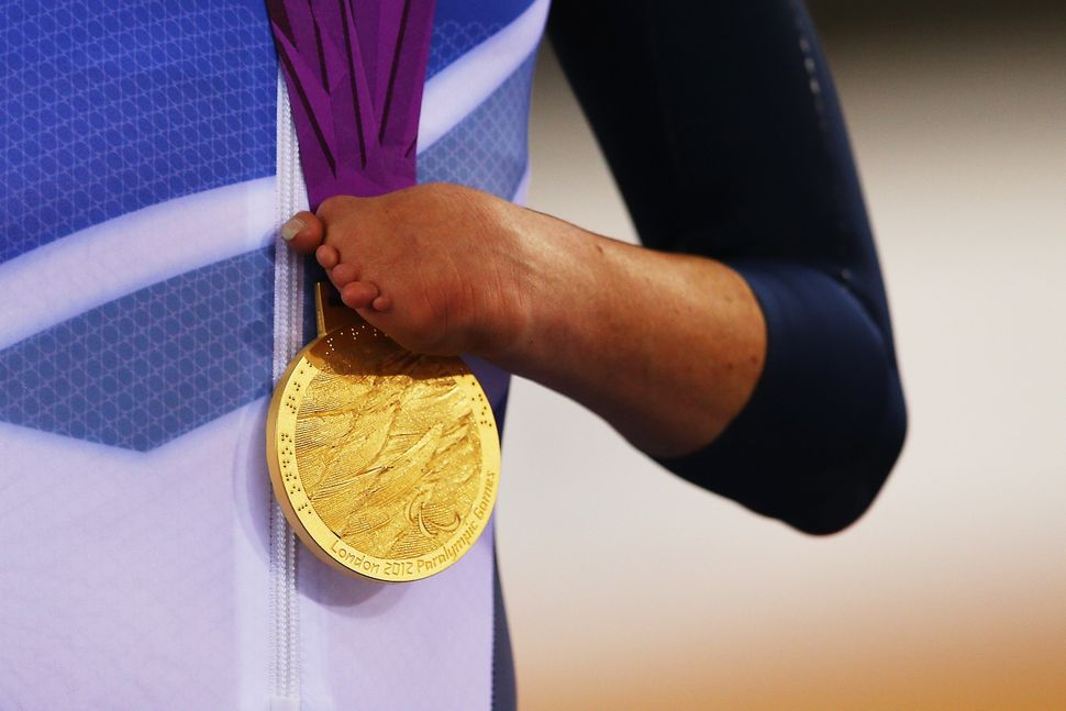 Gold medalist Sarah Storey of Great Britain holds her medal during a victory ceremony in 2012.