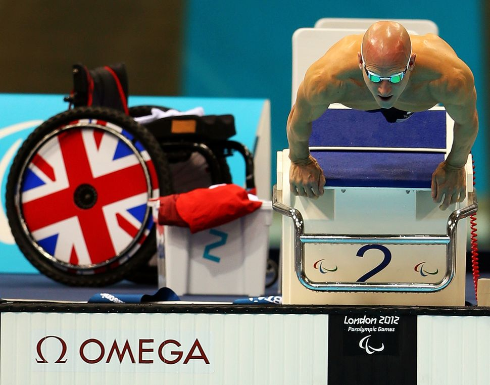 Great Britain's James O'Shea dives from the blocks in the men's 100-meter breaststroke at the London 2012 Paralympic Games.